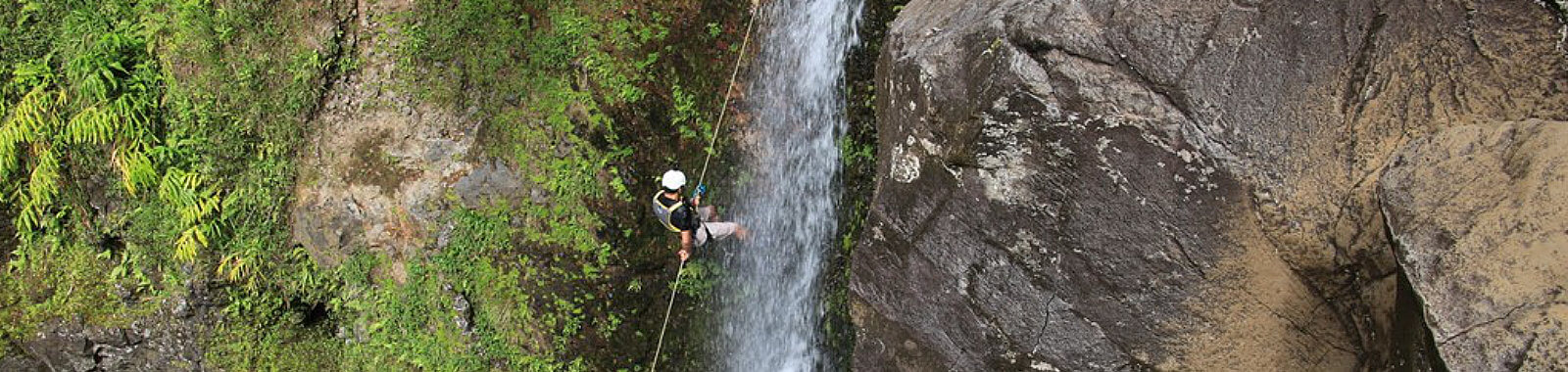 Man Rappeling Waterfall